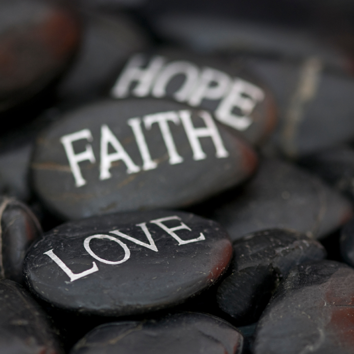 stones with message: love, faith, hope
